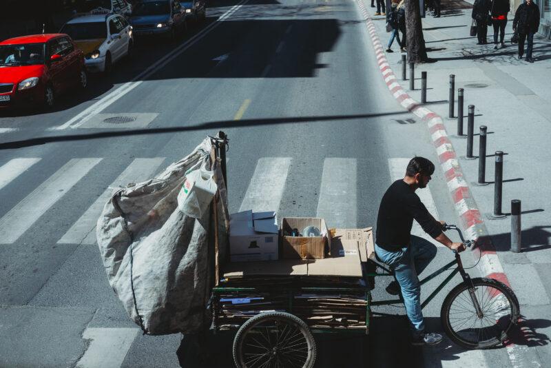Man on cargobike crossing the road