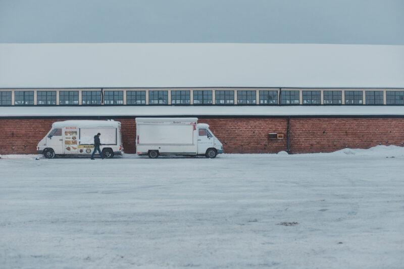 Food trucks parked outside Kvibergs Marknad