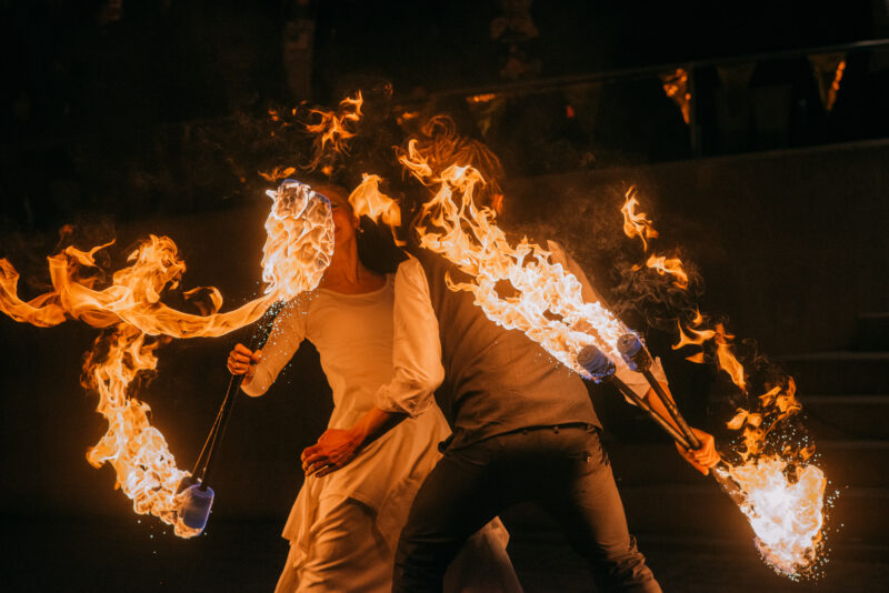 Two fire artists performing