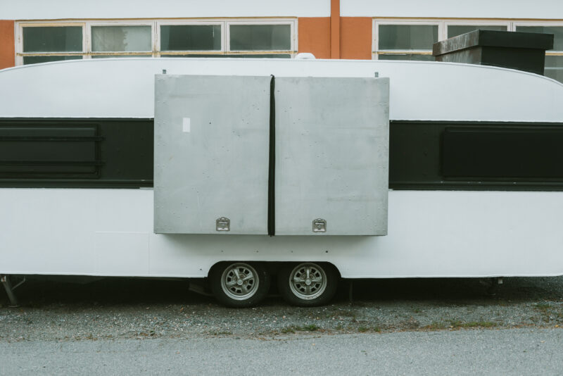 A classic caravan parked on the street