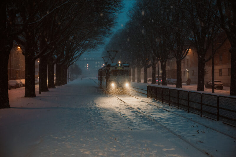 Tram number three during some falling snow
