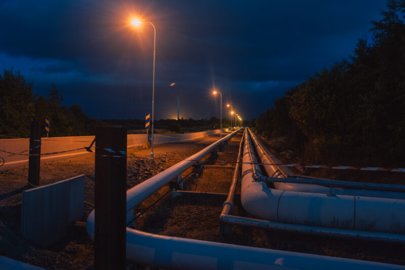 Industrial pipes leading into the horizon