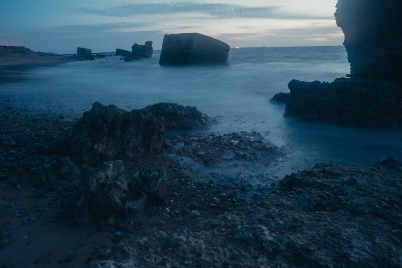 Abandoned ruins half sunken into the sea
