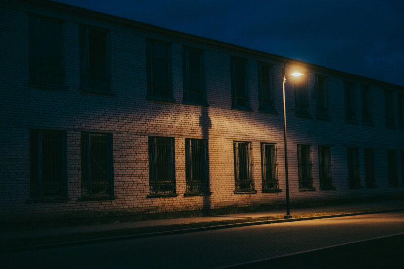 Street light outside an abandoned building