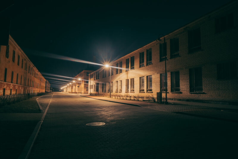 Dark street lined with old abandoned buildings in the Daugavpils Fortress