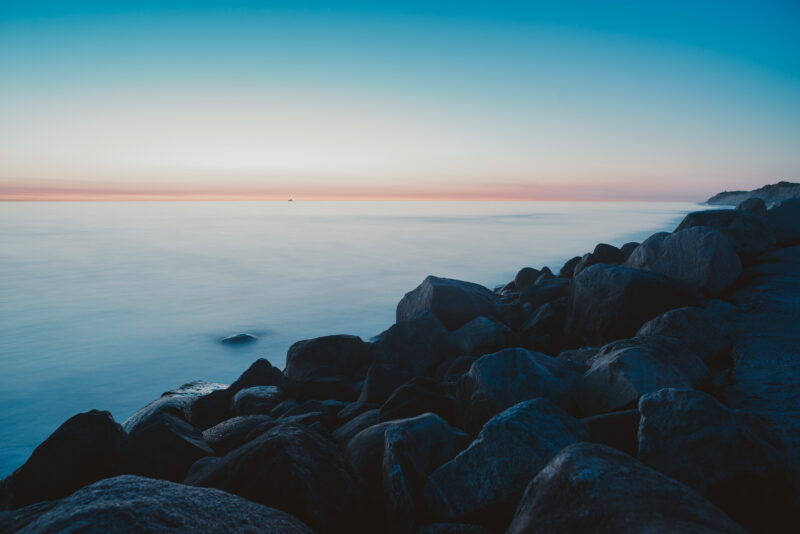Nightly seascape with water and stones