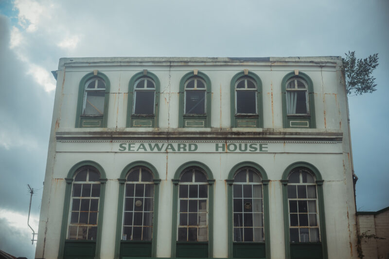 Old white building with the name Seaward House written on it