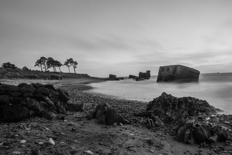 Shoreline with half sunken ruins in the sea