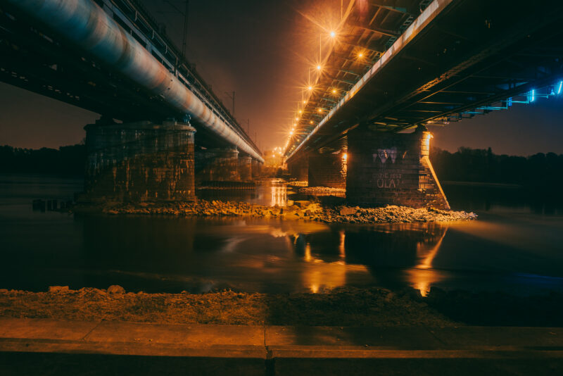 Perspective from between two bridges leading over a river